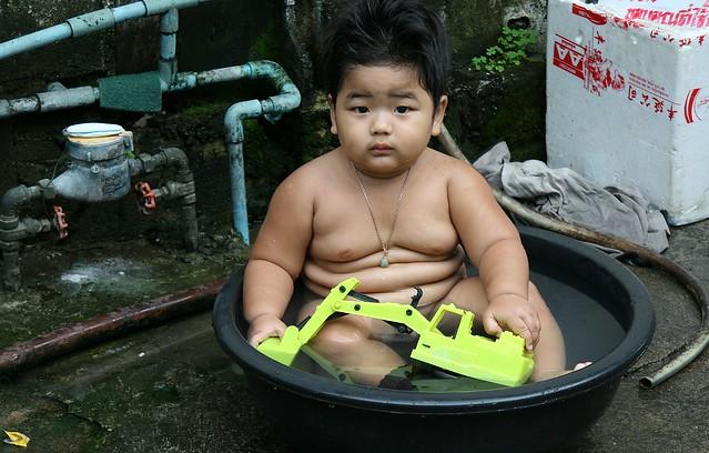 the michelin man as a boy bathing