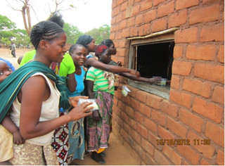 Mothers redeeming vouchers at a rural shop in Katete | by ColaLife