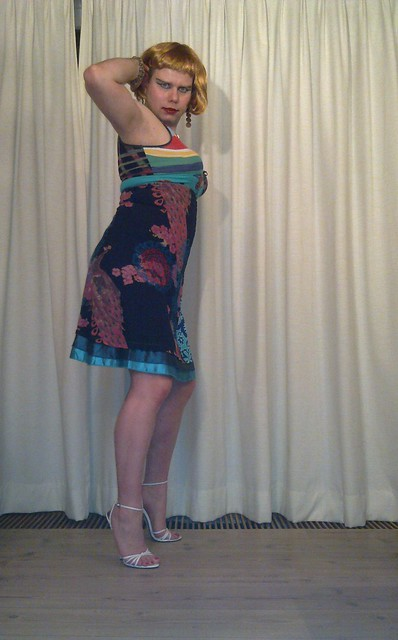 girl in little party dress and stiletto mules