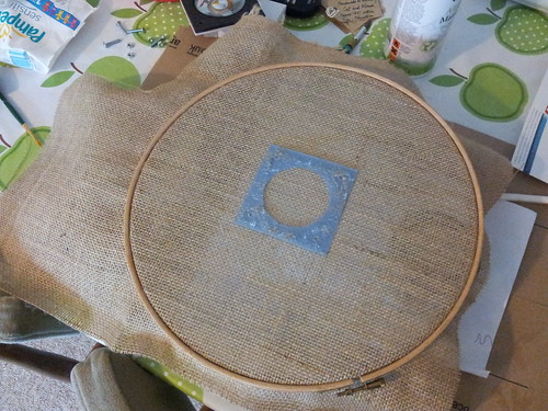 Using embroidery hoop to pull hessian taut before gluing | by lilspikey