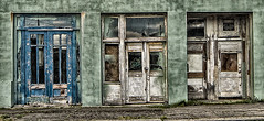 grungy green storefront