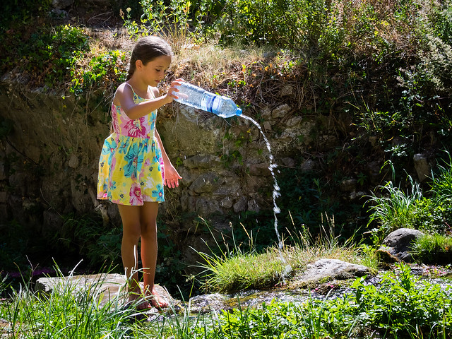 Young Girl playing with Water.