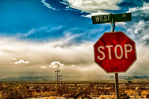 california sky usa sun mountains west dusty rain sign rock clouds landscape nikon desert streetsign stop stopsign d200 hdr gettyimages deserthotsprings flickrfriday niksoftware hbmike2000 walk50stepsandshoot michaellkaser