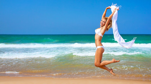 Jumping happy girl on the beach | by Be-Younger.com