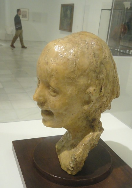 Bambina che ride (e persona che passa distratta) - Medardo Rosso - Museo Reina Sofia