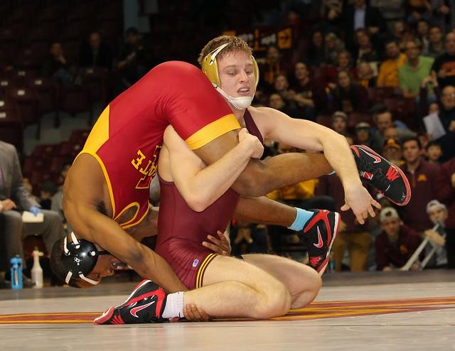 174 - Nick Wanzek (Minnesota) dec. Lelund Weatherspoon (Iowa State) 8-6. Photo by Mark Beshey.