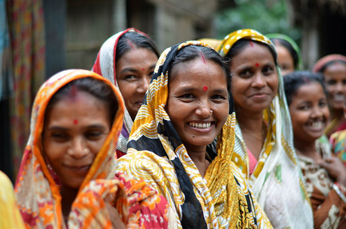 Smiling Farmers Gathered During Morning Milk Collection in Bangladesh | by IFPRI