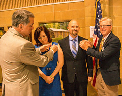 Past President Rich Lewis and current President Scott Tarkenton pinning new members Chase and Tressa Sutphin.