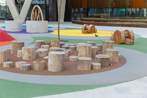 Seats made of logs at a playground | by marcoverch