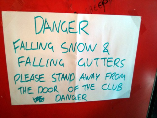 Falling snow and falling gutters sign, 1 in 12 Club, Bradford, UK | by gruntzooki