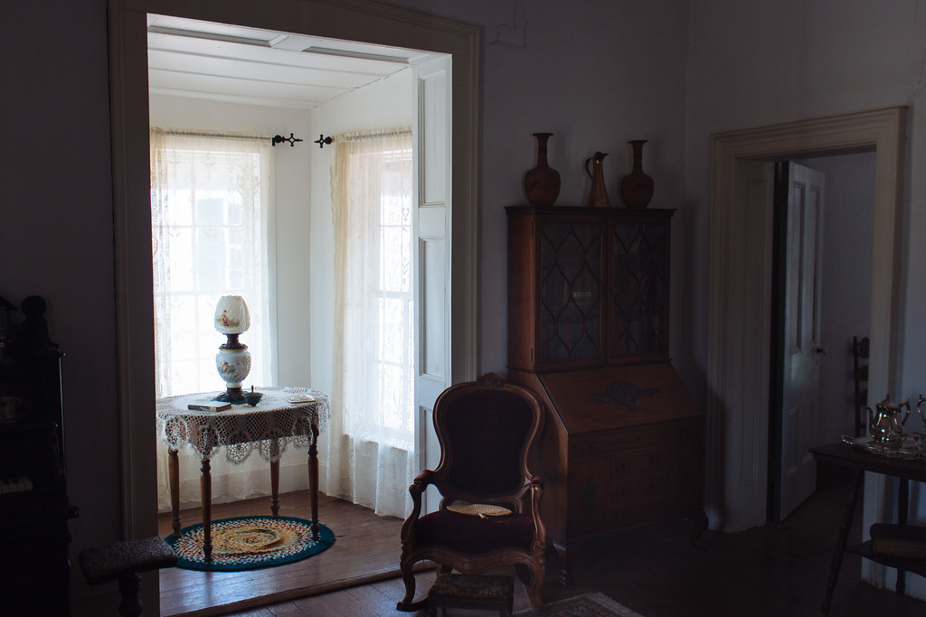 Late 1800s furniture and decorations inside a dimly lit room