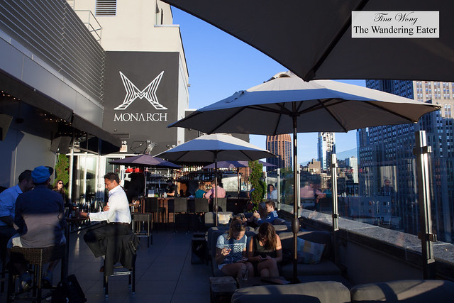 View of the outdoor lounge and bar at sunset