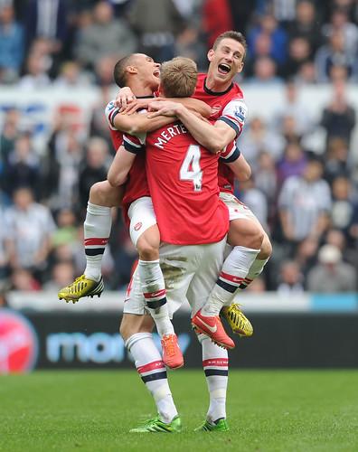 Laurent Koscielny, Kieran Gibbs and Per Mertesacker celebrate after the match