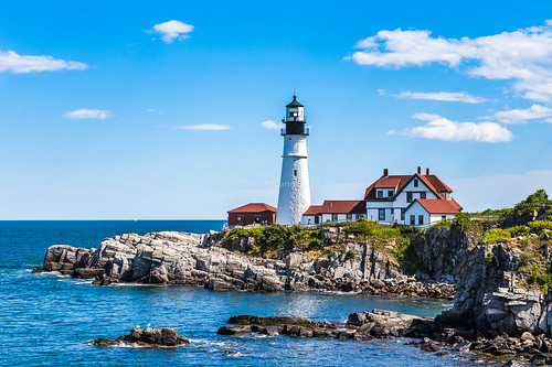 usa canon maine lighthouse iconic rock rocks sky clouds fair day daytime summer red roof beacon