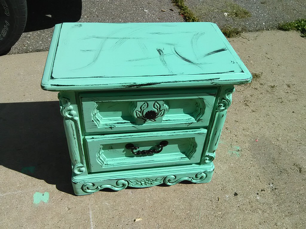 A Vintage Green Shabby Nightstand With A Distressed Look