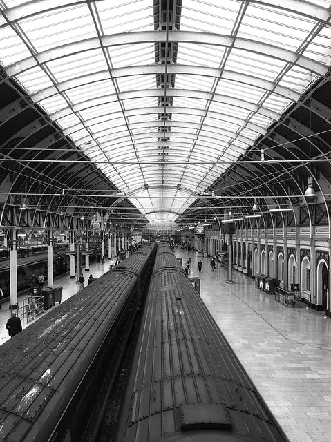 Great lines at Paddington. The footbridge at the country end of Platforms 1 and 2 gives this great tunnel effect. The lines converge on a wonderfully ornate screen above the main concourse. [Zoom for a closer look - Flickr doesn't do portrait very well]