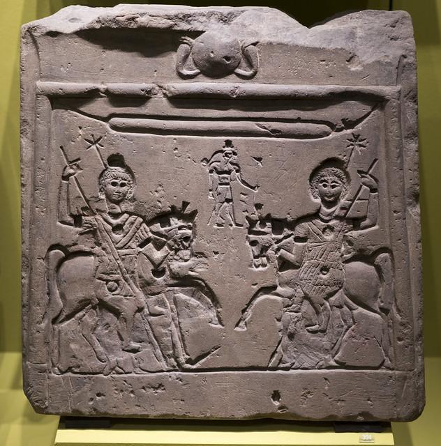 Roman-period Egyptian limestone stele representing the Dioscuri and Horus