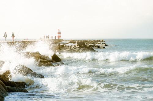 2015 portugal praiadarocha jetty breakers waves mist foam spray lighthouse nikon d7000 sunrise light glow rocks ocean sea