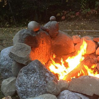 From another angle, it looks like a couple, and larger of the pair is a #heartshapedrock (and could be holding a heart)! #maine #mainelife #firepit at home ❤️ | by Dana Moos