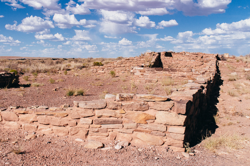 An archaeological site of stone dwellings in flat grassland