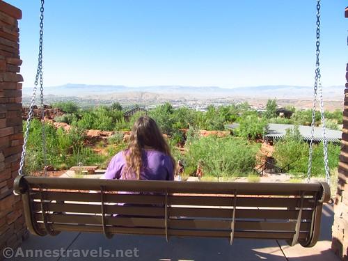 Swinging on a convenient porch swing in the Red Hills Desert Garden, Utah