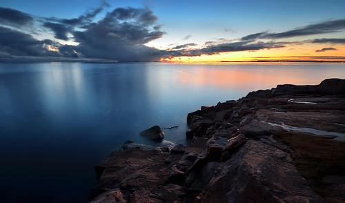 seascape sea seashore sunset rocks reflection clouds suomenlinna horizon helsinki