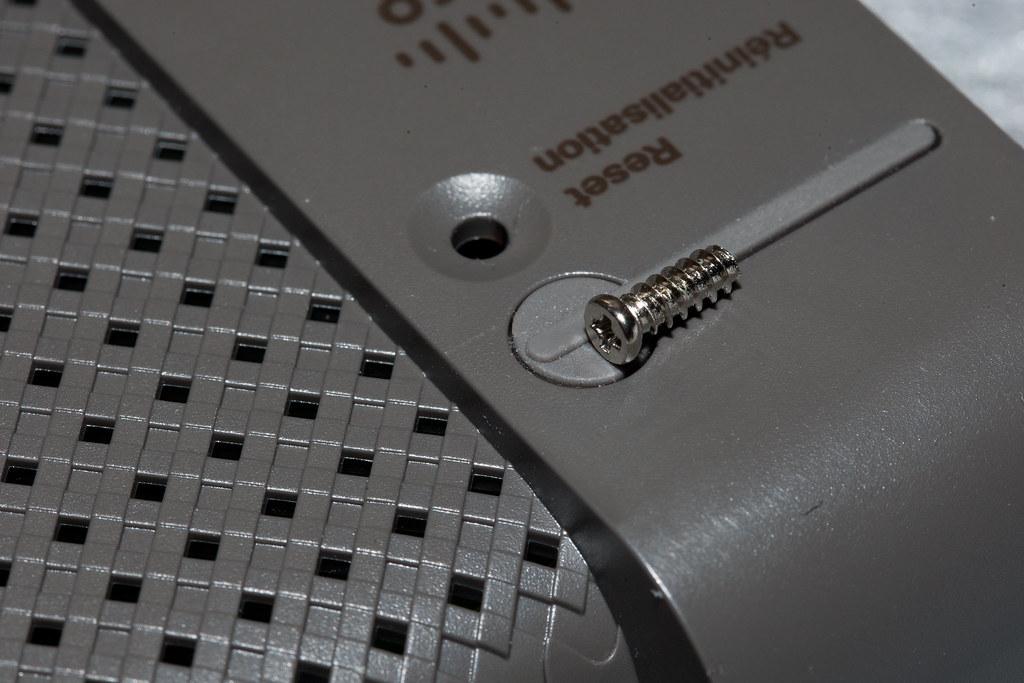 Cisco Linksys E2500-3b (Bottom Screw Removal) | One of three