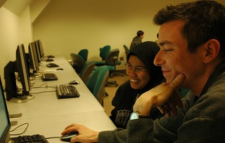All smiles, Instructor Jim Loter with a student, after class answering questions, computer lab, Infomatics, iSchool, Mary Gates Hall, University of Washington, USA | by Wonderlane