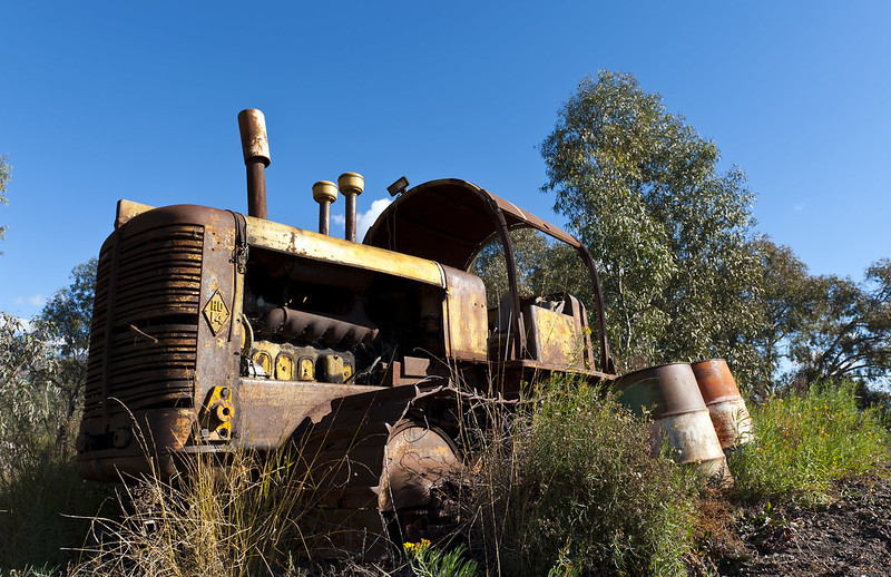 Old tractor harnessed to irrigation pump