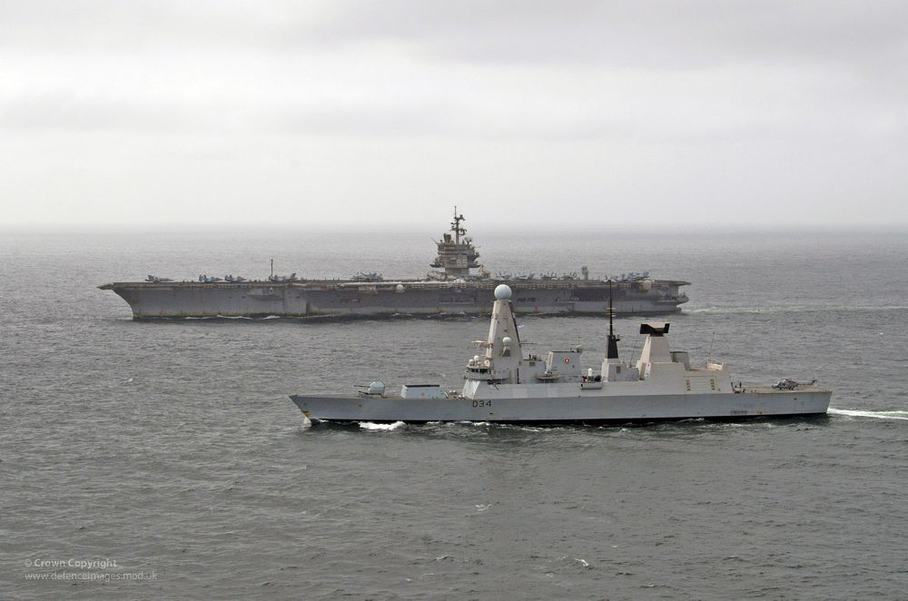 US Aircraft Carrier USS Enterprise Sailing with HMS Diamond