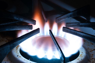 Burning gas stovetop in darkened room - closeup | by D Coetzee