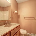 Upstairs bathroom with nice vanity and countertop.
