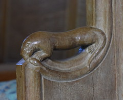 bench end: otter and fish (1950s)