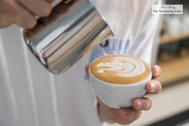 Andrew Bassett making latte art for the cappuccino