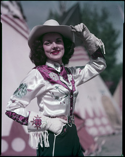 Queen's attendant in costume at the Calgary Stampede / Une demoiselle de la Reine en costume au Stampede de Calgary | by BiblioArchives / LibraryArchives