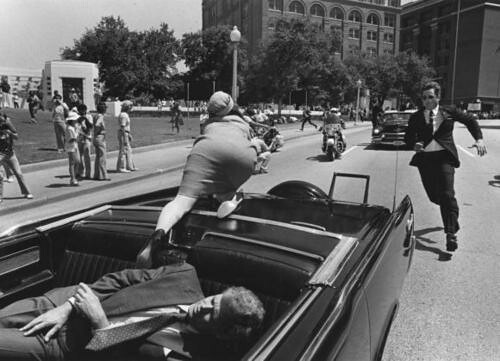 Jackie Kennedy reaches for help after President JFK is shot in Dallas, Texas - 1963