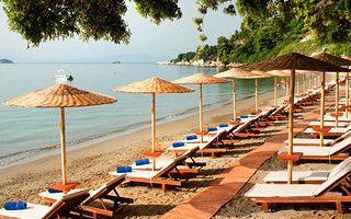 Vasilias beach is equipped with Umbrellas and Sun-beds | by KB Collection Hotels & Resorts
