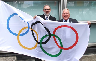 Bob Neill raises the Olympic flag outside Eland House | by Ministry of Housing, Communities and Local Govt