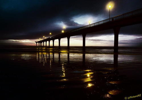 sunrise sunup dawn twilight black yellow lights lamplight heavy cloud dark sombre lowtide shore seashore pacific ocean sea sand beach ripples pier newbrighton southisland nz newzealand darkness notturno nocturno nocturnal stevetaylor