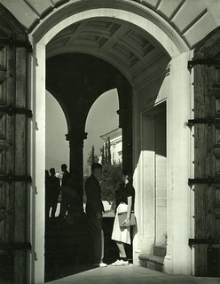 Student talking in archway of Clark Hall in 1940