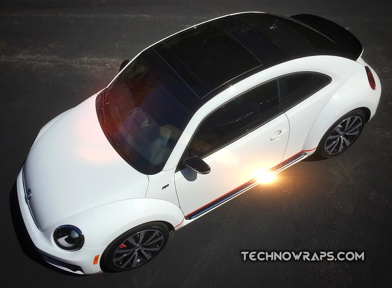 Gloss black car roof wrap by TechnoSigns in Orlando