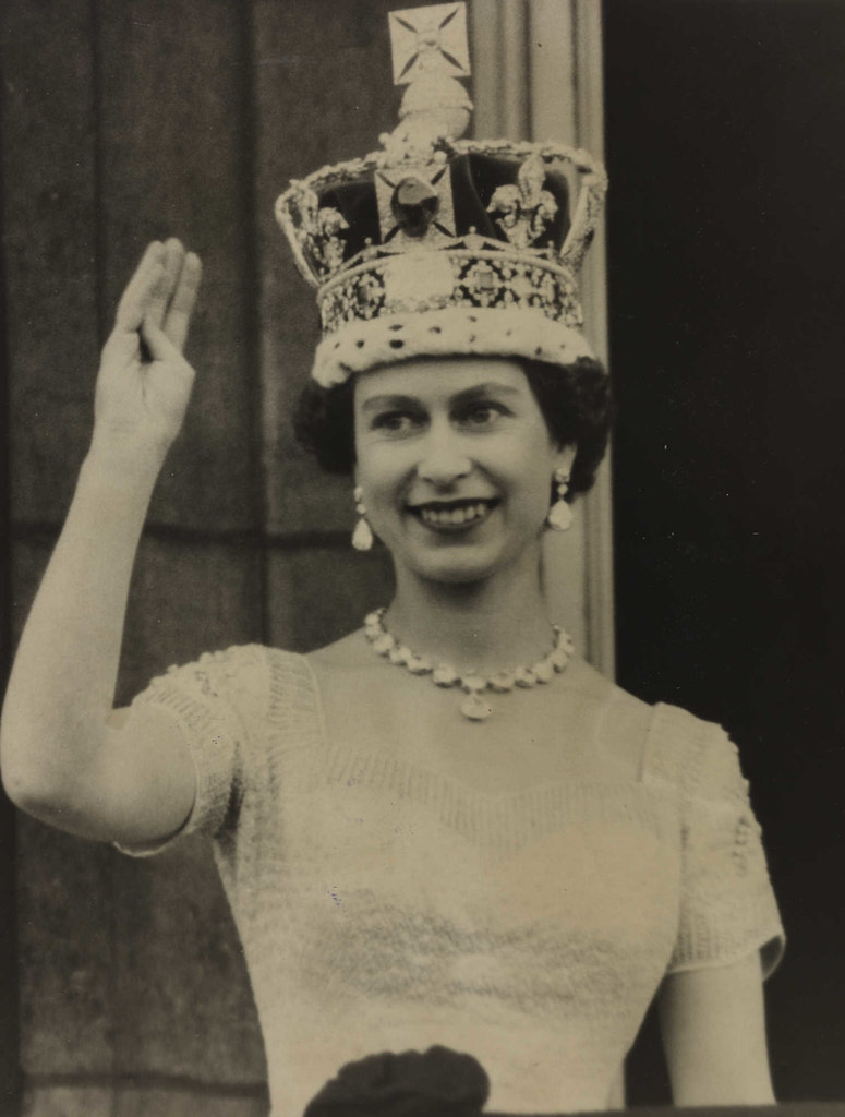 The Queen waves from the palace balcony after the Coronation, 1953.
