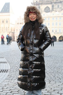Japanise tourist in shiny puffy downcoat hood up
