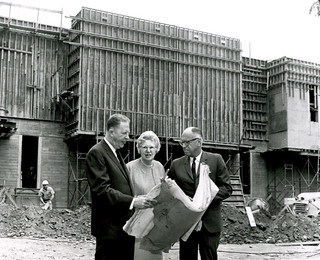 Thatcher Music Building, under construction in 1969. President E. Wilson Lyon examines drawings with donor Madge Rice Thatcher and Richard Nimmons '35, VP for development