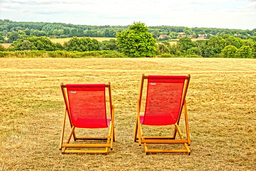 drought parched dry summer lawn grass chairs deckchairs trees houses sky fields nationaltrust