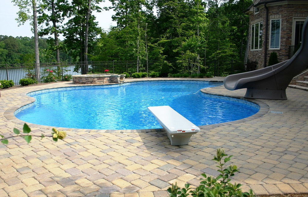 Free form pool and spa with diving board and slide | Flickr