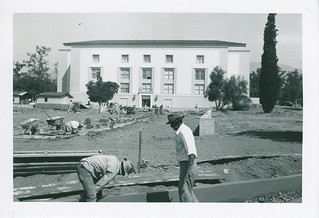 Construction workers in front of the newly completed Honnold Library in September 1950