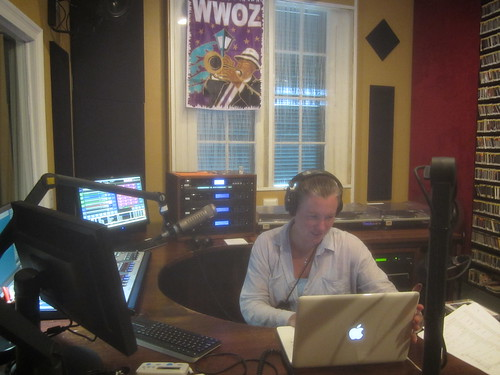 Suzanne Corley on the air at WWOZ!  Note the shutters are still closed from the storm preparations.