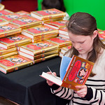 Young reader in bookshop | A peek at Jacqueline Wilson's book in the bookshop