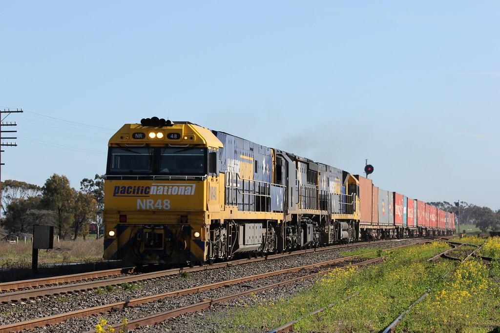 NR48 XRB562 and NR39 make good speed through Murtoa on a late running AM3 by bukk05